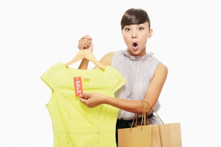 Woman in shock after checking the sale sign on dress Stock Photo - 9605679