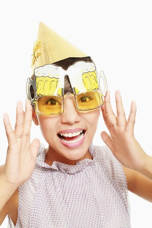 the novelty: Woman with party hat and novelty glasses Stock Photo