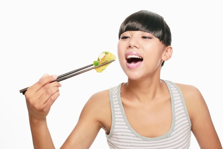 Woman eating chinese food with chopsticks photo