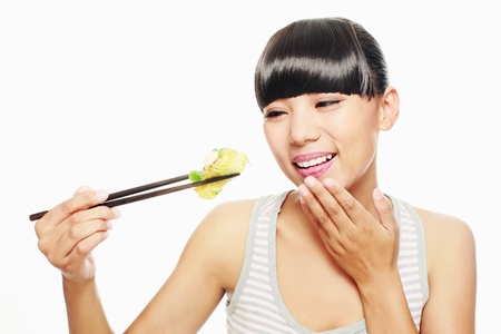 Woman eating chinese food with chopsticks