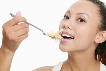 Woman eating salad photo