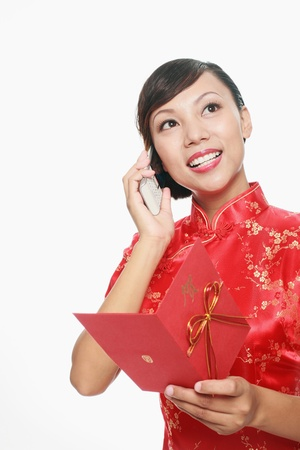 Woman talking on the phone while holding greeting card photo