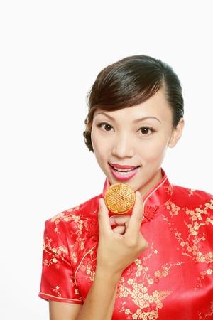cheongsam: Woman eating moon cake