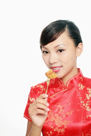 Woman eating moon cake photo