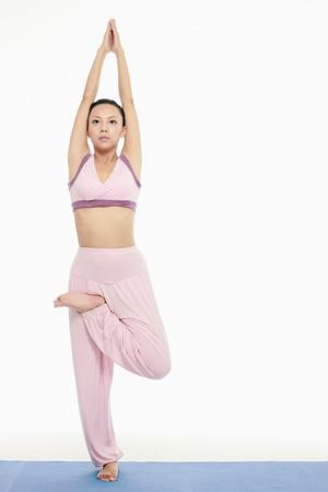 Woman practising yoga Stock Photo - 9604829
