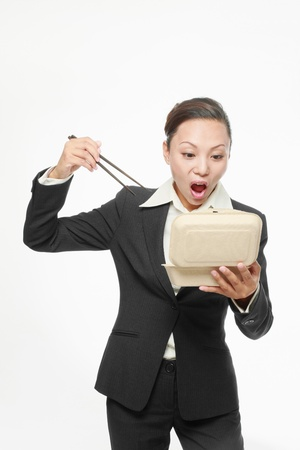 Businesswoman about to eat her take out food Stock Photo - 9605605