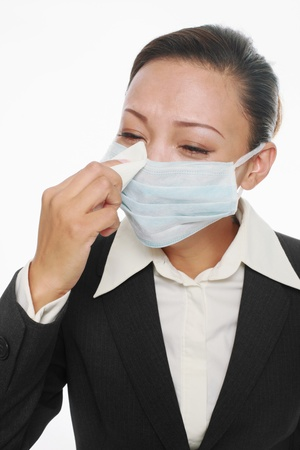 facial tissue: Businesswoman with surgical mask holding facial tissue Stock Photo
