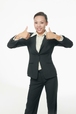 Businesswoman showing thumbs up photo