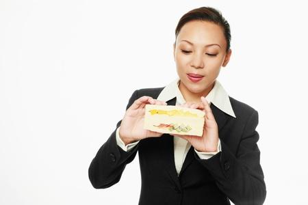 adult sandwich: Businesswoman looking at her sandwich
