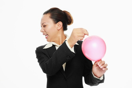 Businesswoman preparing to pop balloon photo