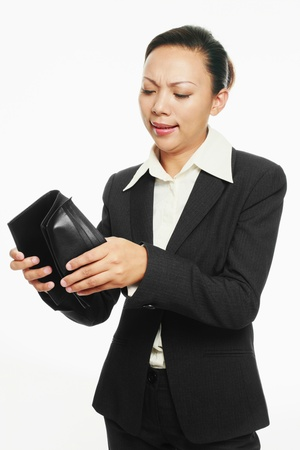 Businesswoman looking into her wallet photo