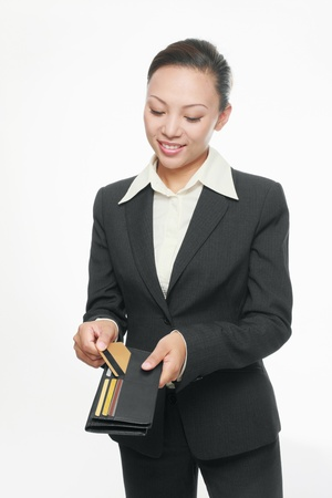 Businesswoman taking out credit card from her wallet photo