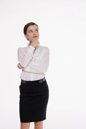 Businesswoman touching chin while thinking photo