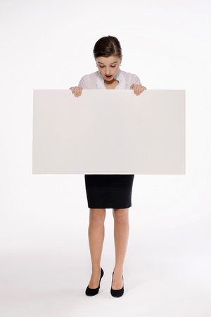 Businesswoman with white placard Stock Photo - 9605257