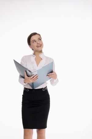 Businesswoman reading document and thinking photo