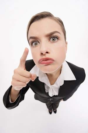 Businesswoman pointing and warning Stock Photo - 9605610