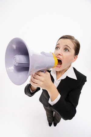 Businesswoman shouting through a megaphone Stock Photo - 9605240