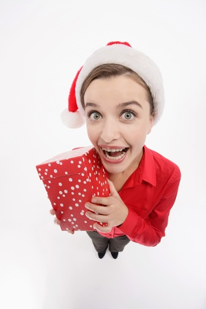 Businesswoman with santa hat holding a present Stock Photo - 9605254
