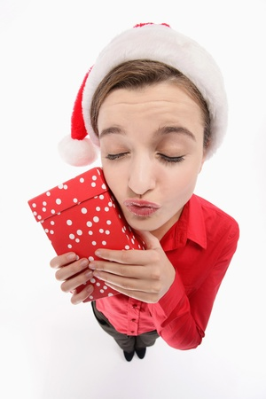 Businesswoman with santa hat holding a present photo