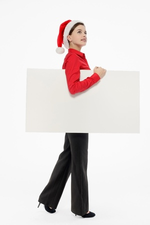 Businesswoman with santa hat holding placard Stock Photo - 9605184