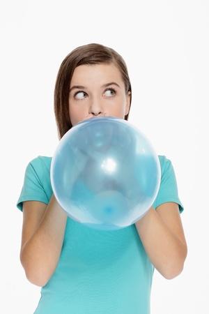 Woman blowing balloon photo