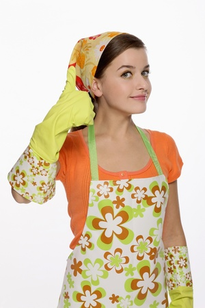 Woman in apron showing hands with rubber gloves on photo