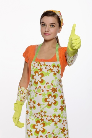 Woman in apron showing thumbs up photo