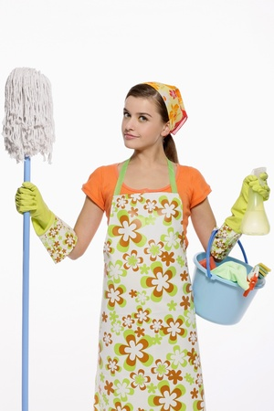 cleaning products: Woman in apron holding mop and a pail of cleaning products