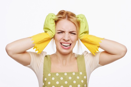 Woman in apron looking frustrated Stock Photo - 9605614