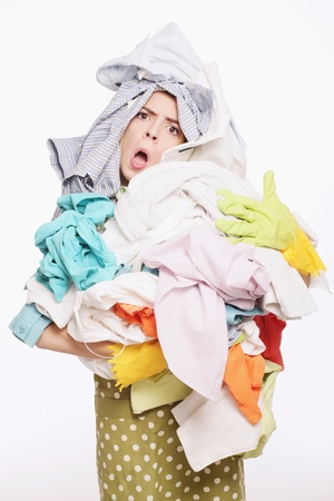 Woman with a pile of clothing photo