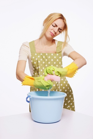 squeezing: Woman squeezing water from cleaning sponge