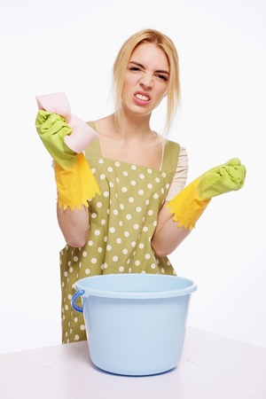 Woman with cleaning sponge looking frustrated Stock Photo - 9605259