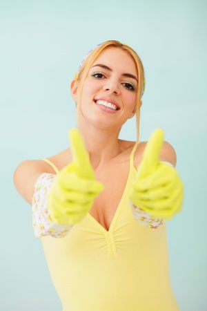 Woman with rubber gloves showing thumbs up photo