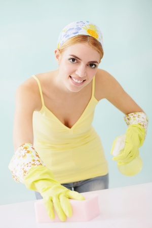 Woman cleaning table photo
