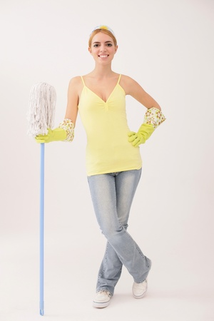 Woman standing and holding mop photo