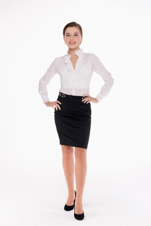 arms akimbo: Businesswoman standing with arms akimbo Stock Photo