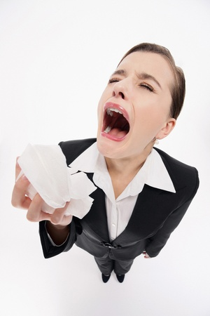 Businesswoman about to sneeze photo