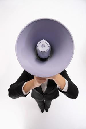 Businesswoman shouting through a megaphone Stock Photo - 9678461