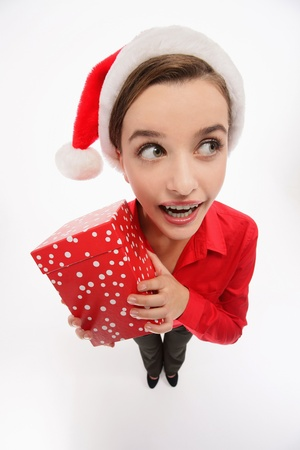 Businesswoman with santa hat holding a present Stock Photo - 9678470