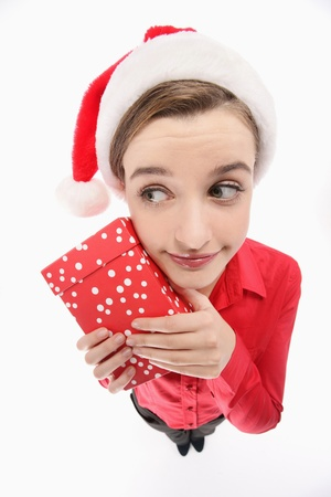 Businesswoman with santa hat holding a present Stock Photo - 9678741