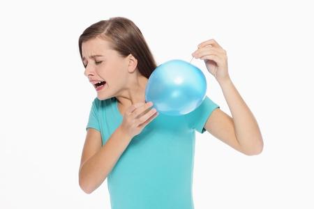 poking: Woman poking balloon with straight pin