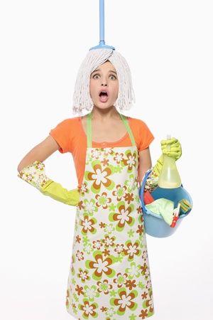 Woman with mop on her head carrying a pail of cleaning products photo