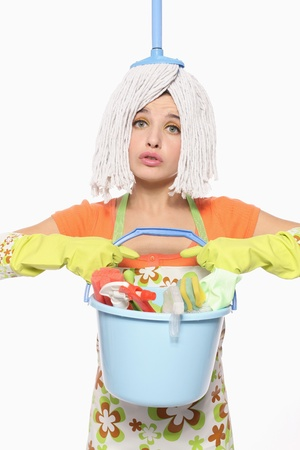 cleaning woman: Woman with mop on her head carrying a pail of cleaning products