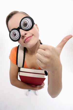 Woman with novelty glasses showing thumbs up photo