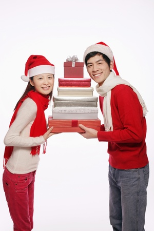 Man and woman holding a stack of gift boxes Stock Photo - 9678176