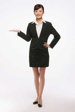 Businesswoman with her arm outstretched