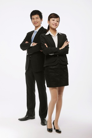 chinese business: Businessman and businesswoman with their arms crossed Stock Photo