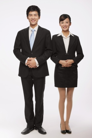 Businessman and businesswoman smiling Stock Photo - 9678360