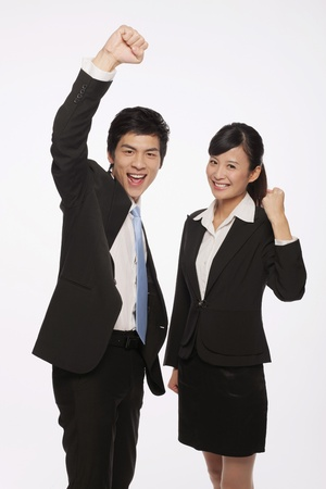 Businessman and businesswoman celebrating their success photo