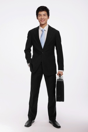 Businessman with a briefcase Stock Photo